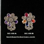 Siver pendant with precious stones