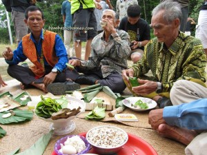 Elders help to prepare the offering to be spread all over the village so all visitors will be protected